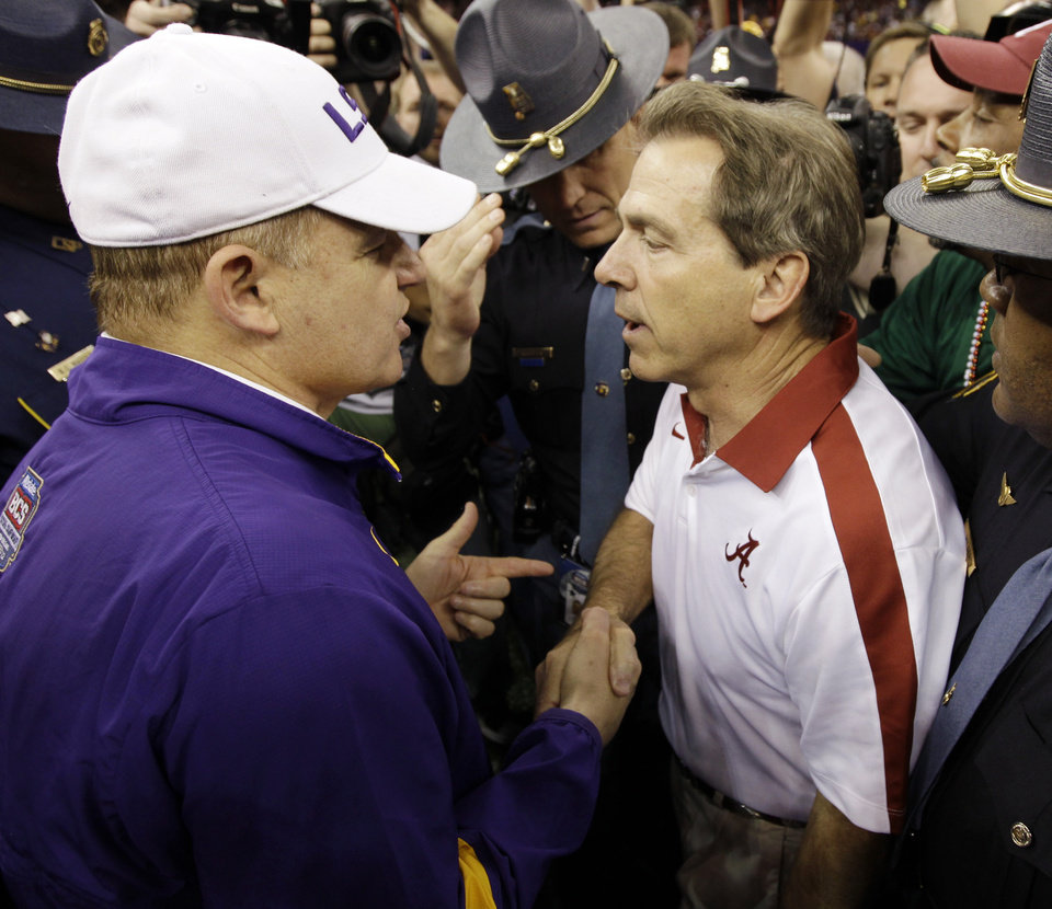 FILE - In this Jan. 9, 2012, file photo, LSU head coach Les Miles, left, talks to Alabama head coach Nick Saban after the Crimson Tide won 21-0 in the BCS National Championship NCAA college football game in New Orleans. Alabama-LSU has become the greatest rivalry in college football, and it\'s time for another epic showdown: No. 1 Crimson Tide vs. No. 5 Tigers on Saturday. (AP Photo/David J. Phillip, File) ORG XMIT: NY159