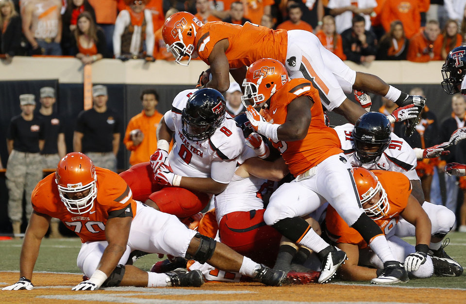 Photo - Oklahoma State's Joseph Randle (1) leaps for a touchdown during a college football game between Oklahoma State University (OSU) and Texas Tech University (TTU) at Boone Pickens Stadium in Stillwater, Okla., Saturday, Nov. 17, 2012.  Photo by Bryan Terry, The Oklahoman
