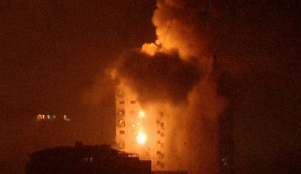 Photo - In this image taken from video an explosion hits the media complex that houses the offices of Hamas-run Al Aqsa television and radio in central Gaza City early on Tuesday, July 29, 2014.  The building also houses offices of a number of Arab satellite television news channels. (AP Photo/APTN)