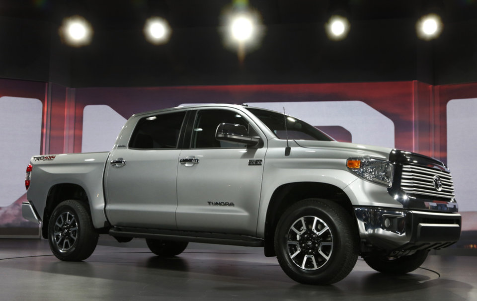 Photo - FILE - In this Thursday, Feb. 7, 2013, file photo, the redesigned 2014 Toyota Tundra is unveiled at the Chicago Auto Show, 2013, in Chicago. In its first major update since 2007, the full-size Toyota Tundra pickup truck is redesigned with a bold, American-style exterior, a refined, quieter interior and standard backup camera and Bluetooth phone and audio connectivity.   (AP Photo/Charles Rex Arbogast, File)