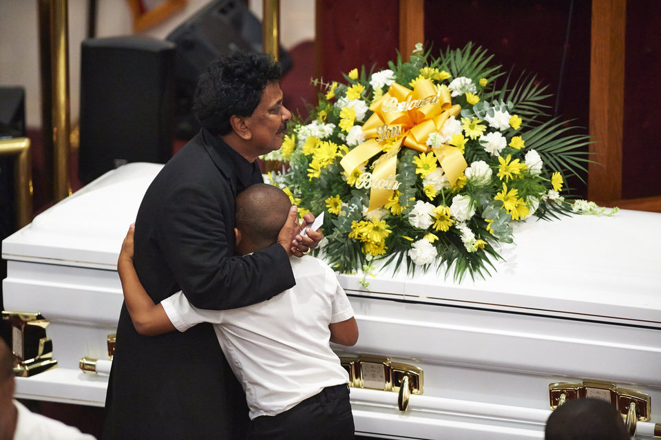 Photo - FILE- In this July 23, 2014 file photo, mourners gather during a funeral service for Eric Garner at Bethel Baptist Church in the Brooklyn borough of New York. A grand jury ruled not to indict the police officer involved in the death of Garner. No firm statistics can say whether a spate of officer-involved deaths is a growing trend or simply a series of coincidences generating a deafening buzz in news reports and social media.(AP Photo/New York Daily News, James Keivom, Pool, File)