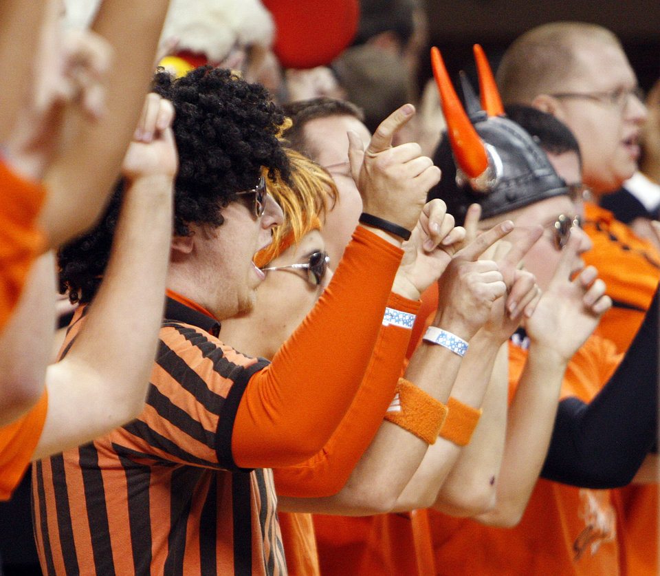 Photo - OSU fans cheer during the men's college basketball game between Oklahoma State University (OSU) and Kansas State University (KSU) at Gallagher-Iba Arena in Stillwater, Okla., Saturday, January 8, 2011. Photo by Nate Billings, The Oklahoman