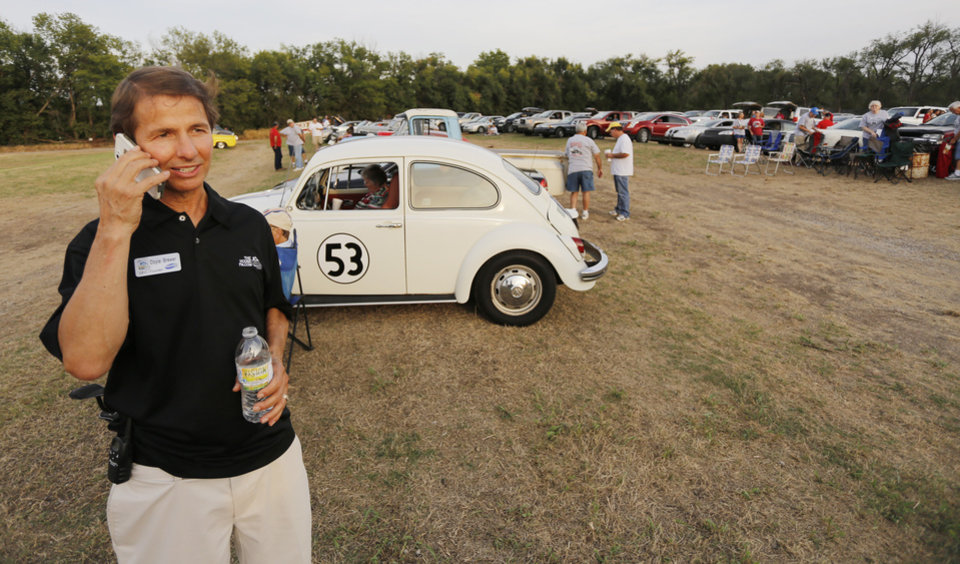 Photo - Doyle Brewer, CEO of KLVV/KJTH, makes sure everything is going smoothly for the special showing of God's NOT Dead at the Airline Drive-in movie theater in Ponca City Thursday, August 14, 2014. Photo by Doug Hoke, The Oklahoman