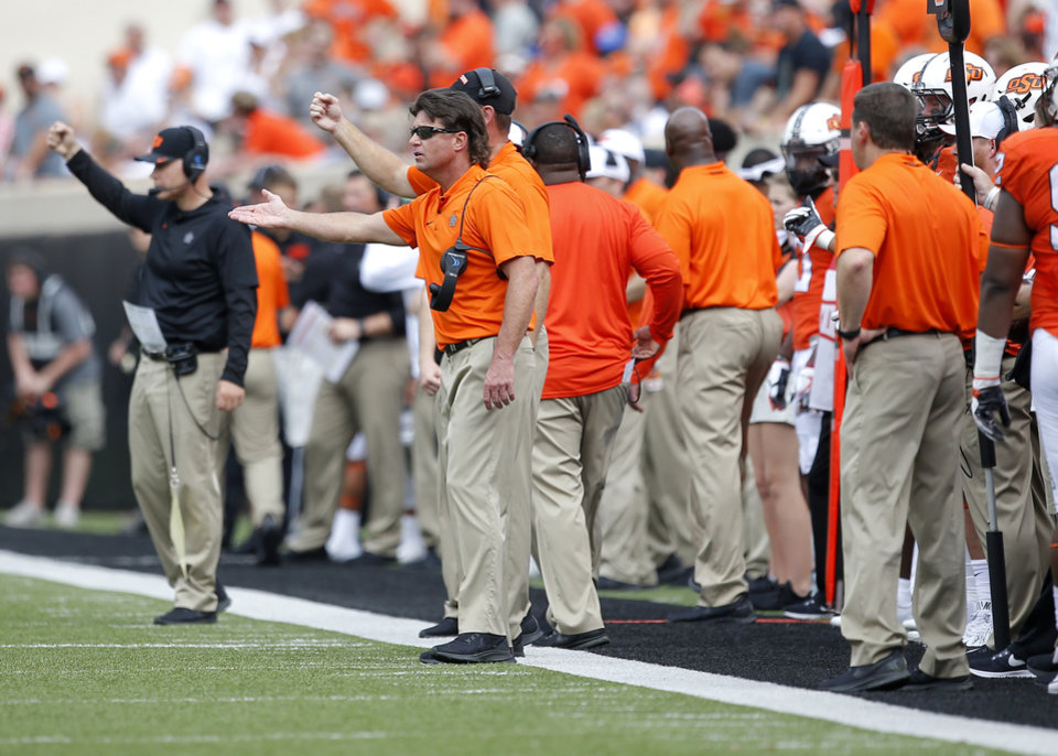 Photo - Oklahoma state head coach Mike Gundy argues a call in the third quarter during a college football game between the Oklahoma State Cowboys (OSU) and the Boise State Broncos at Boone Pickens Stadium in Stillwater, Okla., Saturday, Sept. 15, 2018. OSU won 44-21. Photo by Sarah Phipps, The Oklahoman