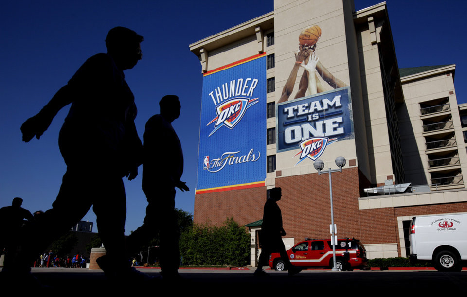 People walk outside the arena before Game 1 of the NBA Finals between the Oklahoma City Thunder and the Miami Heat at Chesapeake Energy Arena in Oklahoma City, Tuesday, June 12, 2012. Photo by Bryan Terry, The Oklahoman