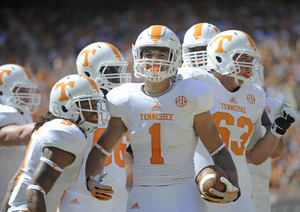Photo - Tennessee running back Jalen Hurd (1) celebrates after scoring a touchdown during the first half of the Orange and White game at Neyland Stadium in Knoxville, Tenn., Saturday, April 12, 2014. (AP Photo/Knoxville News Sentinel, Adam Lau) (AP Photo/Knoxville News Sentinel, Adam Lau)