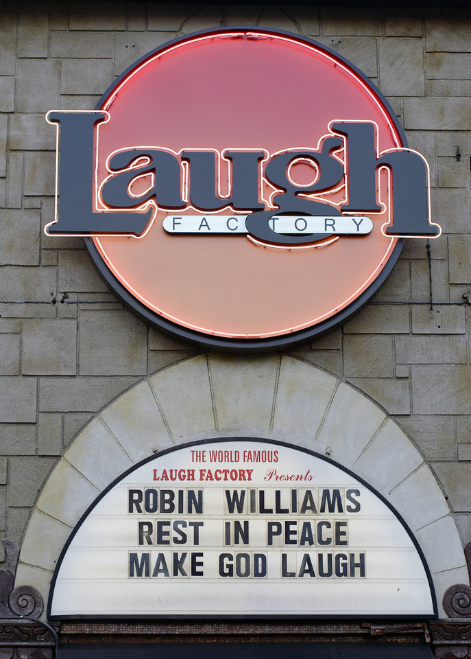 Photo - The marquee of the Laugh Factory shows a message in memory of actor/comedian Robin Williams in the Hollywood district of Los Angeles Monday, Aug. 11, 2014. Williams, the Academy Award winner and comic supernova whose explosions of pop culture riffs and impressions dazzled audiences for decades and made him a gleamy-eyed laureate for the Information Age, died Monday in an apparent suicide at his San Francisco Bay area home. He was 63. (AP Photo/Kevork Djansezian)