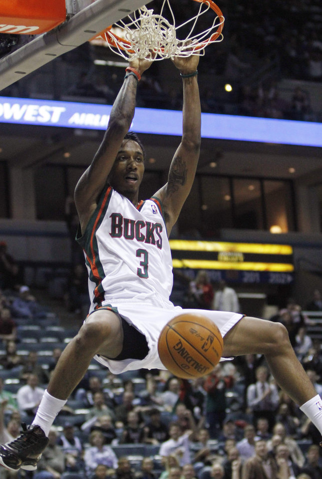 Photo - Milwaukee Bucks' Brandon Jennings dunks during the second half of an NBA basketball game against the New Jersey Nets on Wednesday, Nov. 18, 2009, in Milwaukee. The Bucks won 99-85. (AP Photo/Morry Gash) ORG XMIT: WIMG109