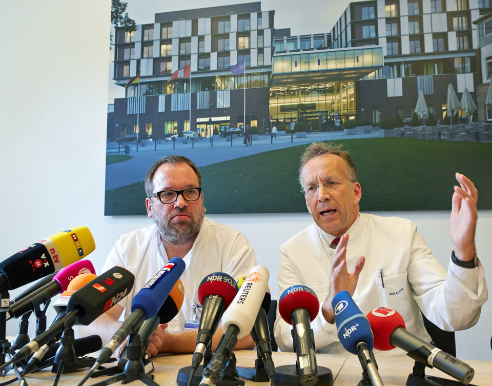 Photo - The doctor helping oversee the treatment, Stefan Schmiedel,, left, and  Internal Medicine  Director of the University Medical Center Hamburg-Eppendorf,  Ansgar Lohse, attend a press conference in the hospital in Hamburg, Wednesday Aug. 27, 2014. A scientist who was infected with Ebola while working for the World Health Organization in Sierra Leone began receiving treatment Wednesday in a Hamburg hospital after being flown overnight to Germany. The man, whose name and condition are being withheld for patient privacy reasons, is being treated at the U.N. agency's request in city's University Medical Center Hamburg-Eppendorf, home to the well-known Bernhard-Nocht Clinic for Tropical Medicine.   (AP Photo/dpa, Georg Wendt)