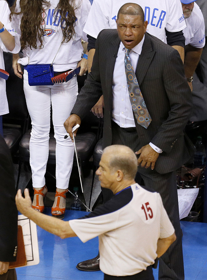 Photo - Clippers coach Doc Rivers shouts towards official Bennett Salvatore after the a possession call late in Game 5 of the Western Conference semifinals in the NBA playoffs between the Oklahoma City Thunder and the Los Angeles Clippers at Chesapeake Energy Arena in Oklahoma City, Tuesday, May 13, 2014. Photo by Bryan Terry, The Oklahoman