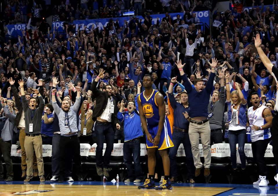 Photo - Oklahoma City fans celebrate Russell Westbrook's game-winning three-pointer during overtime as Golden State's Harrison Barnes (40) reacts in the NBA game between the Oklahoma City Thunder and the Golden State Warriors at the Chesapeake Energy Arena, Friday, Nov. 29, 2013. Photo by Sarah Phipps, The Oklahoman