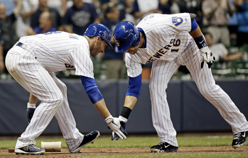 Photo -   Milwaukee Brewers' Aramis Ramirez (16) is congratulated by Ryan Braun after hitting a two-run home run during the eighth inning of a baseball game against the Pittsburgh Pirates Friday, Aug. 31, 2012, in Milwaukee. (AP Photo/Morry Gash)