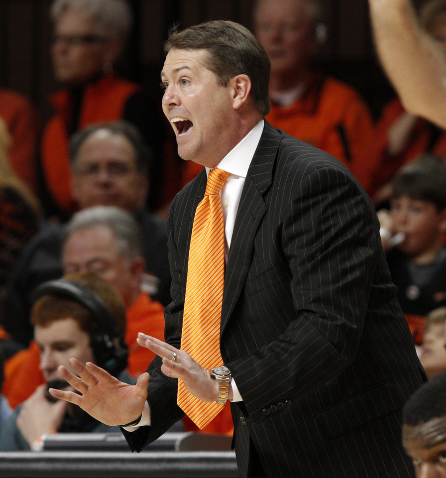 Photo - OSU coach Travis Ford gives instructions to his team during a first-round NIT college basketball game between Oklahoma State University (OSU) and Harvard at Gallagher-Iba Arena in Stillwater, Okla., Tuesday, March 15, 2011. Photo by Bryan Terry, The Oklahoman