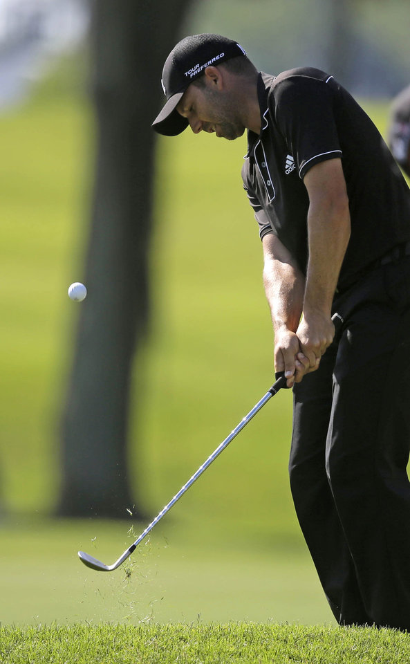 Photo - Sergio Garcia hits onto the ninth green during a practice round for The Players championship golf tournament at TPC Sawgrass in Ponte Vedra Beach, Fla., Wednesday, May 7, 2014. (AP Photo/Gerald Herbert)