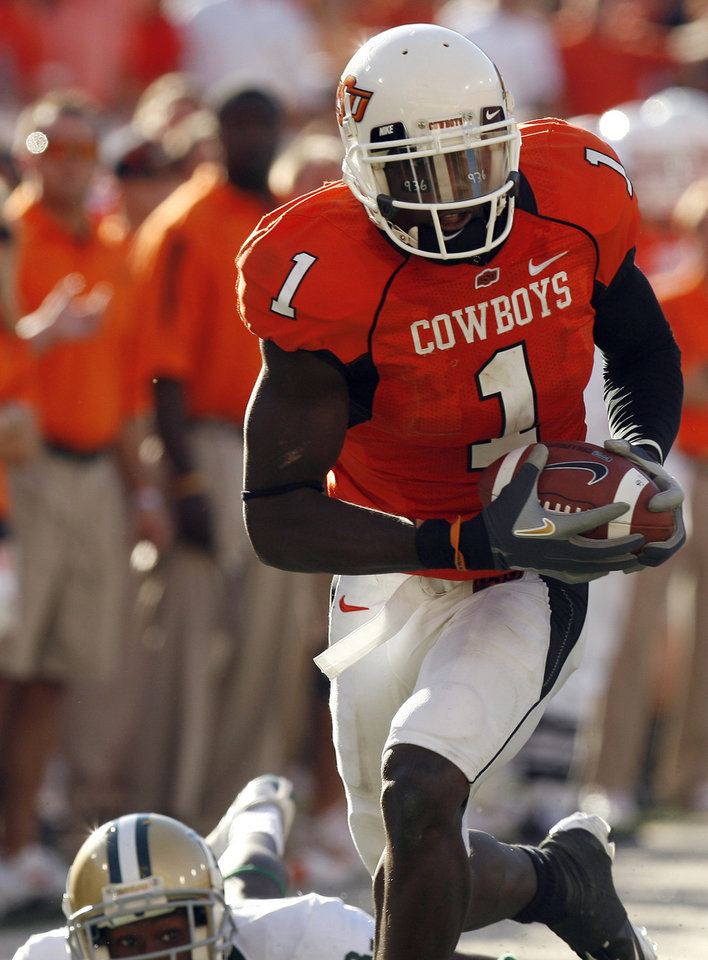 Photo - OSU'S Dez Bryant (1) runs past BU's Antareis Bryan (3) at the Oklahoma State University (OSU) college football game with Baylor University (BU) at Boone Pickens Stadium in Stillwater, Okla. Saturday, Oct. 18, 2008. BY SARAH PHIPPS, THE OKLAHOMAN. ORG XMIT: KOD