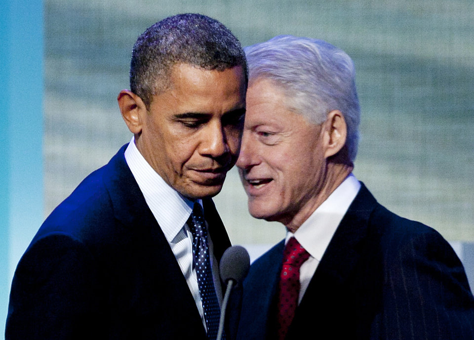 Photo -   President Barack Obama steps to the microphone after being introduced by former President Bill Clinton, Tuesday, Sept. 25, 2012, at the Clinton Global Initiative in New York. (AP Photo/Mark Lennihan)
