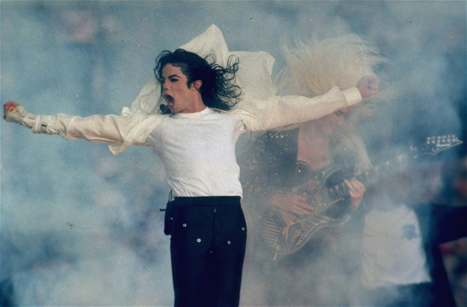 FILE - In this Jan. 31, 1993 file picture, Michael Jackson performs during the halftime show at the Super Bowl XXVII in Pasadena, Calif. Jackson has died in Los Angeles at age 50 on Thursday, June 25, 2009. (AP Photo/Rusty Kennedy) ORG XMIT: NYET723