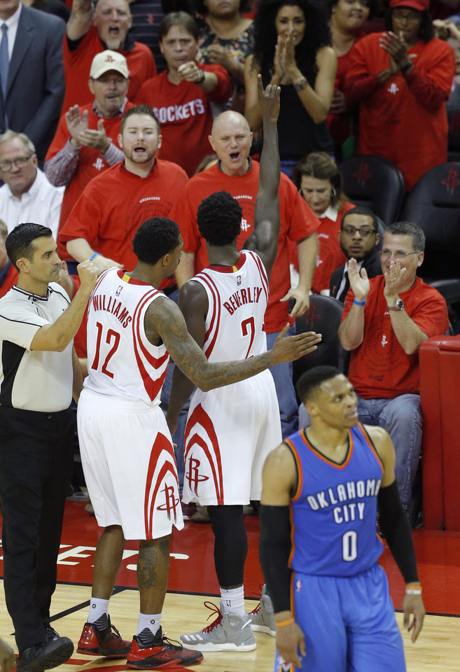 Photo - Houston's Patrick Beverley (2) celebrates with fans after a foul by Oklahoma City's Russell Westbrook (0) during Game 5 in the first round of the NBA playoffs between the Oklahoma City Thunder and the Houston Rockets in Houston, Texas,  Tuesday, April 25, 2017.  Photo by Sarah Phipps, The Oklahoman