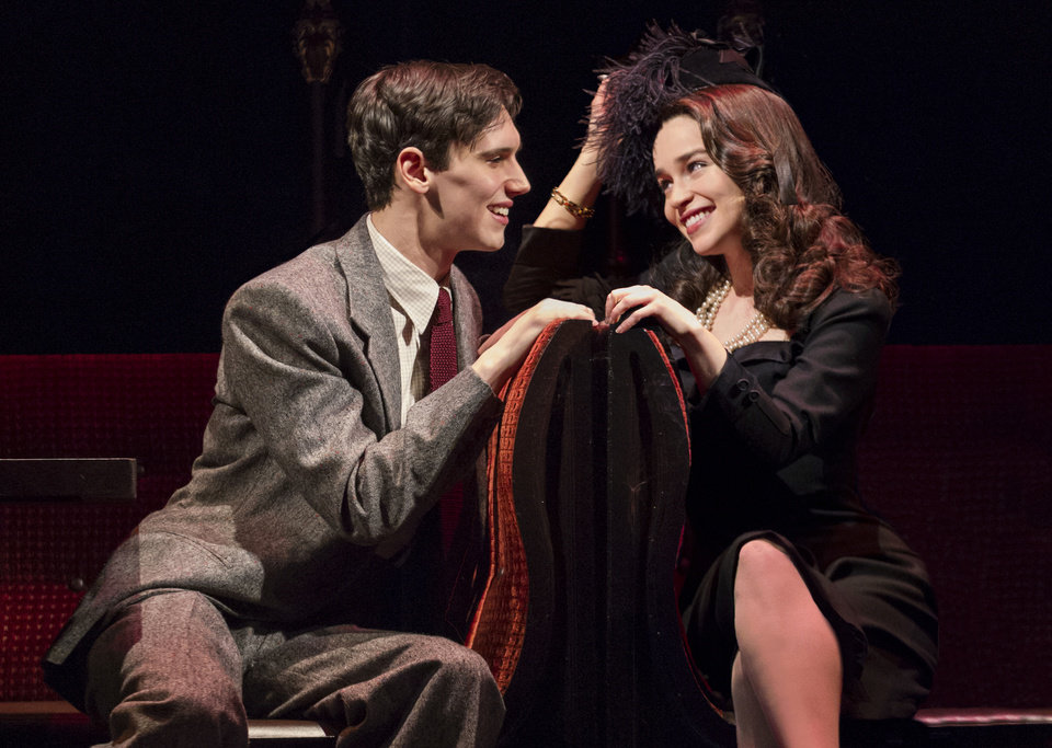 Photo - This theater image released by The O+M Company shows Cory Michael Smith, left, and Emilia Clarke in a scene from