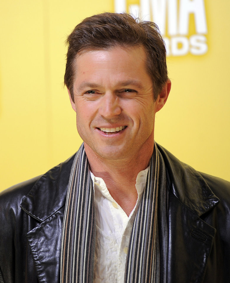 Photo -   Eric Close arrives at the 46th Annual Country Music Awards at the Bridgestone Arena on Thursday, Nov. 1, 2012, in Nashville, Tenn. (Photo by Chris Pizzello/Invision/AP)