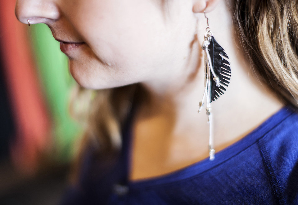 Photo - For those who use bicycles for commuting to work or errands, cycling fashion is going from spandex to multi-functional such as this jewelry made from recycled tire tubes. (Courtney Perry/Minneapolis Star Tribune/MCT)
