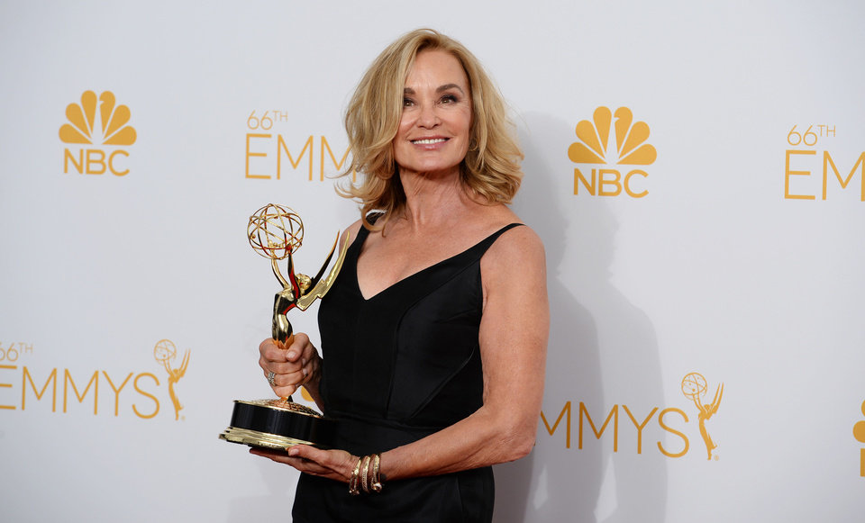 Photo - Jessica Lange poses in the press room at the 66th Annual Primetime Emmy Awards at the Nokia Theatre L.A. Live on Monday, Aug. 25, 2014, in Los Angeles. (Photo by Jordan Strauss/Invision/AP)