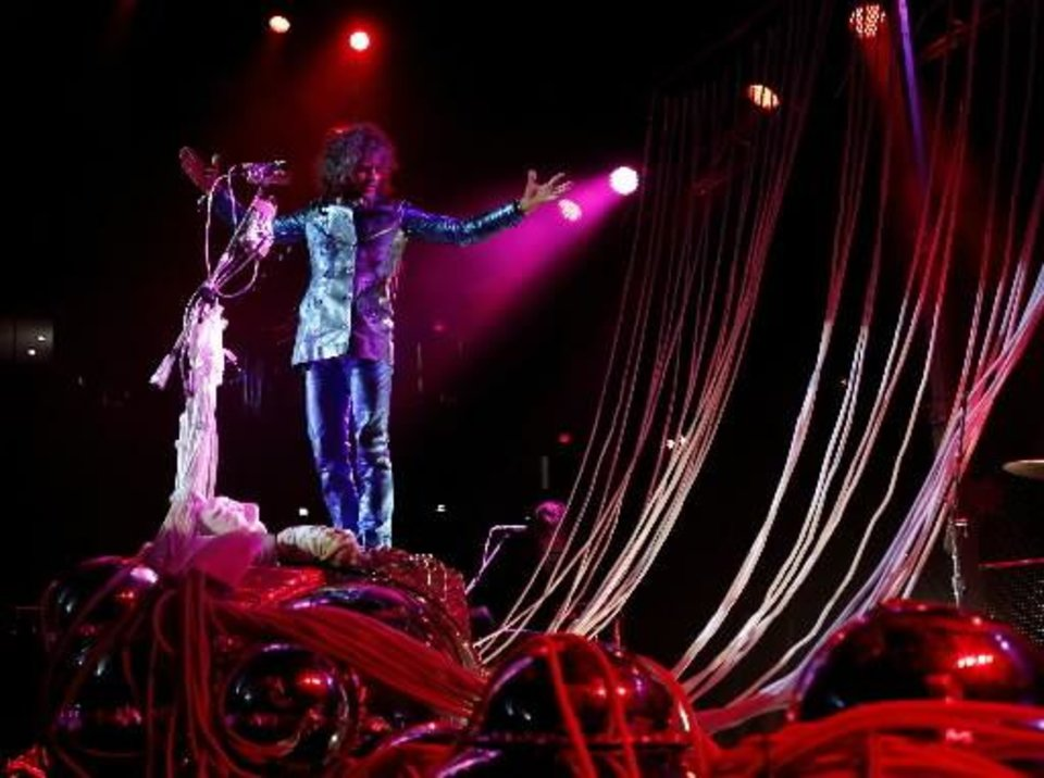 "Wayne Coyne with The Flaming Lips performs during the ""Rock for Oklahoma"" tornado relief concert at the Chesapeake Energy Arena in OKlahoma City, Tuesday, July 23, 2013. Photo by Bryan Terry, The Oklahoman Archive"