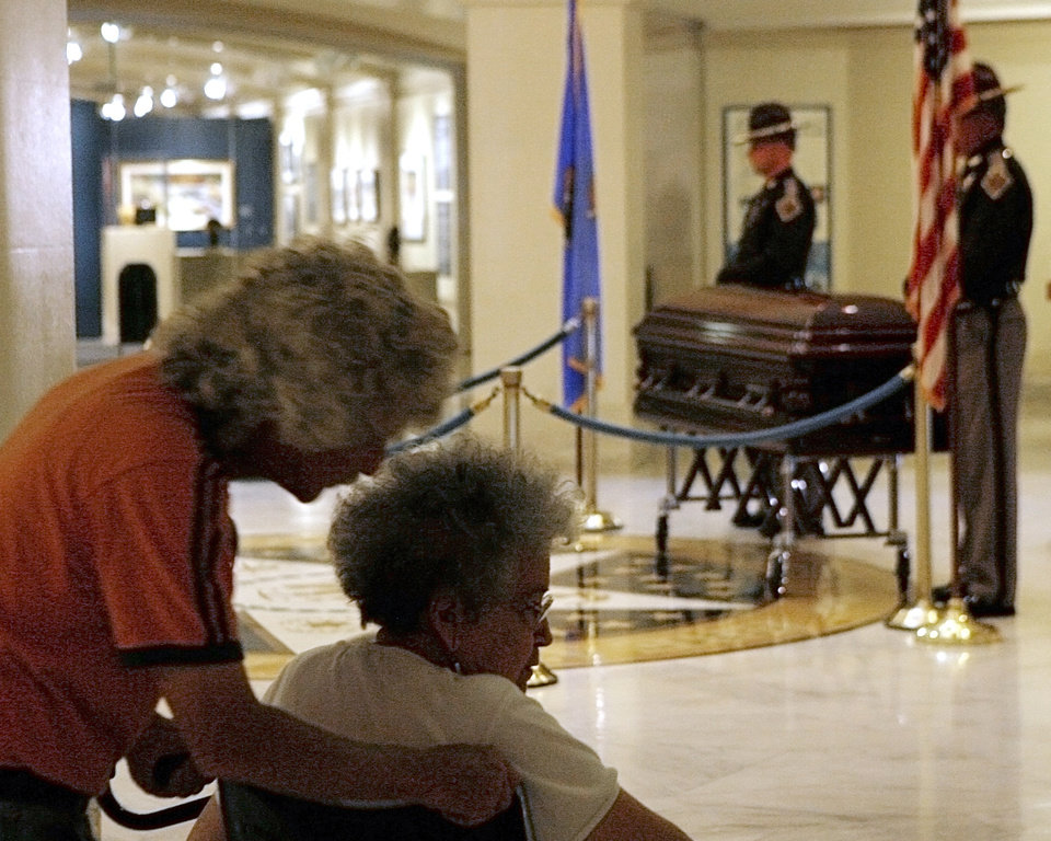 Photo - David Stone and Edith Gardner pay their respects as Clara Luper lies in repose at the Oklahoma State Capitol in Oklahoma City, June 16, 2011. Photo by Garett Fisbeck, The Oklahoman