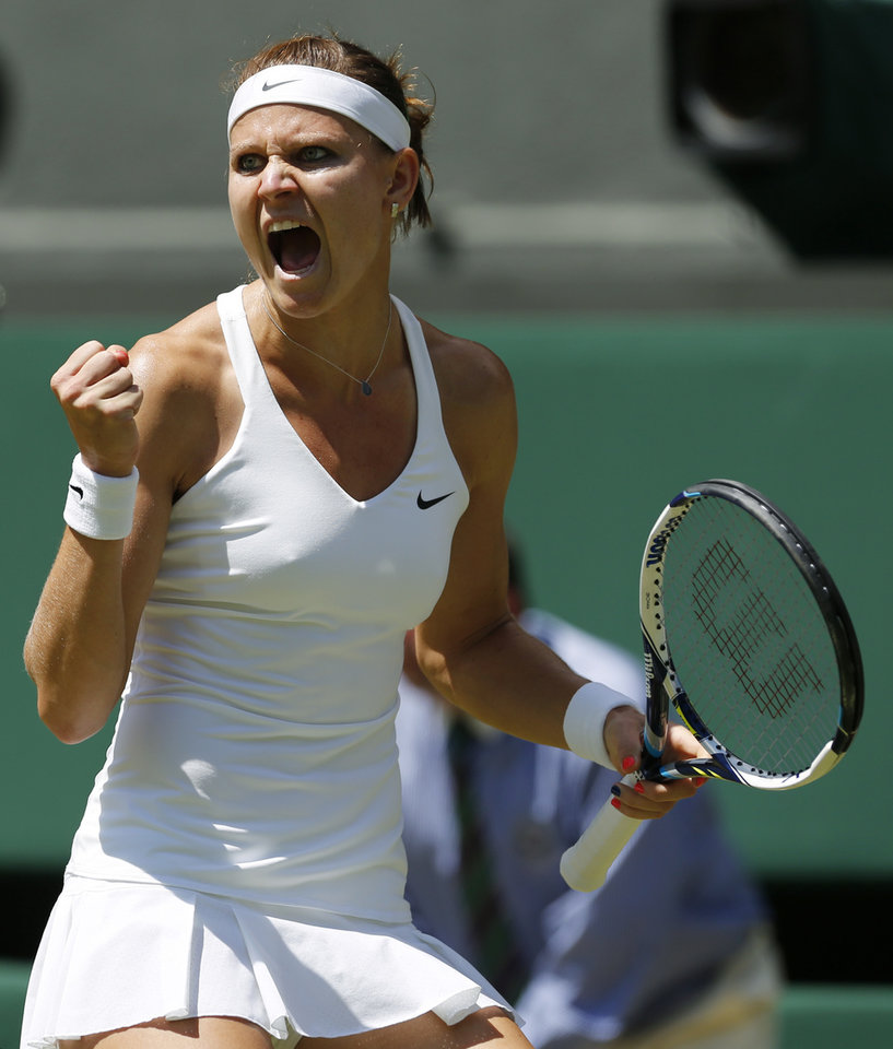 Photo - Lucie Safarova of Czech Republic celebrates after winning a point against Petra Kvitova of Czech Republic during their women's singles semifinal match at the All England Lawn Tennis Championships in Wimbledon, London, Thursday, July 3, 2014. (AP Photo/Ben Curtis)