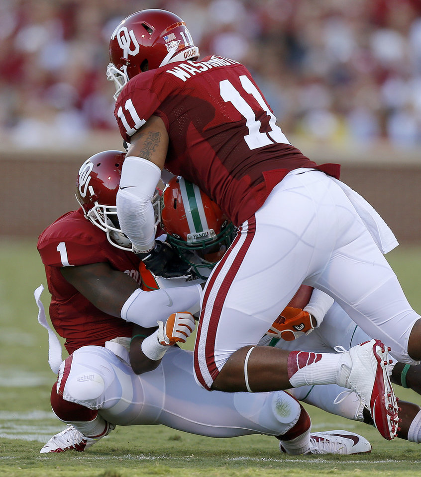 Photo - Oklahoma's Tony Jefferson (1) and R.J. Washington (11) bring down Florida A&M's Eddie Rocker (9) during the college football game between the University of Oklahoma Sooners (OU) and Florida A&M Rattlers at Gaylord Family—Oklahoma Memorial Stadium in Norman, Okla., Saturday, Sept. 8, 2012. Photo by Bryan Terry, The Oklahoman