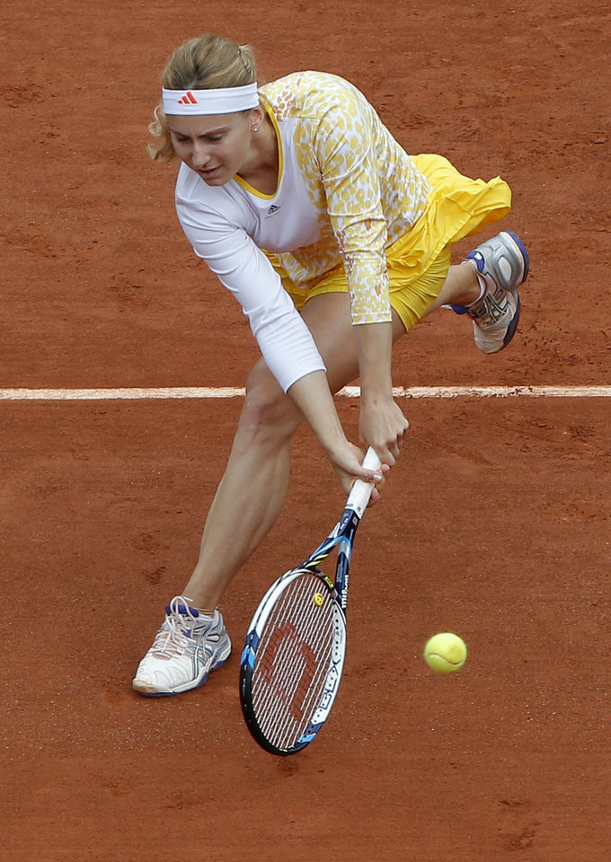 Photo - Russia's Ksenia Pervak returns the ball to compatriot Maria Sharapova during the first round match of  the French Open tennis tournament at the Roland Garros stadium, in Paris, France, Monday, May 26, 2014. (AP Photo/Michel Euler)