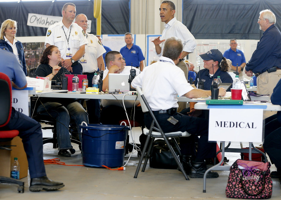 Photo - President Barack Obama talks with first responders at Moore Fire Station no. 1 in Moore, Okla., on Sunday, May 26, 2013. President Obama toured the area in Moore that was hit by a tornado on May, 20, 2013.  Photo by Bryan Terry, The Oklahoman ORG XMIT: OKC1305261402008170