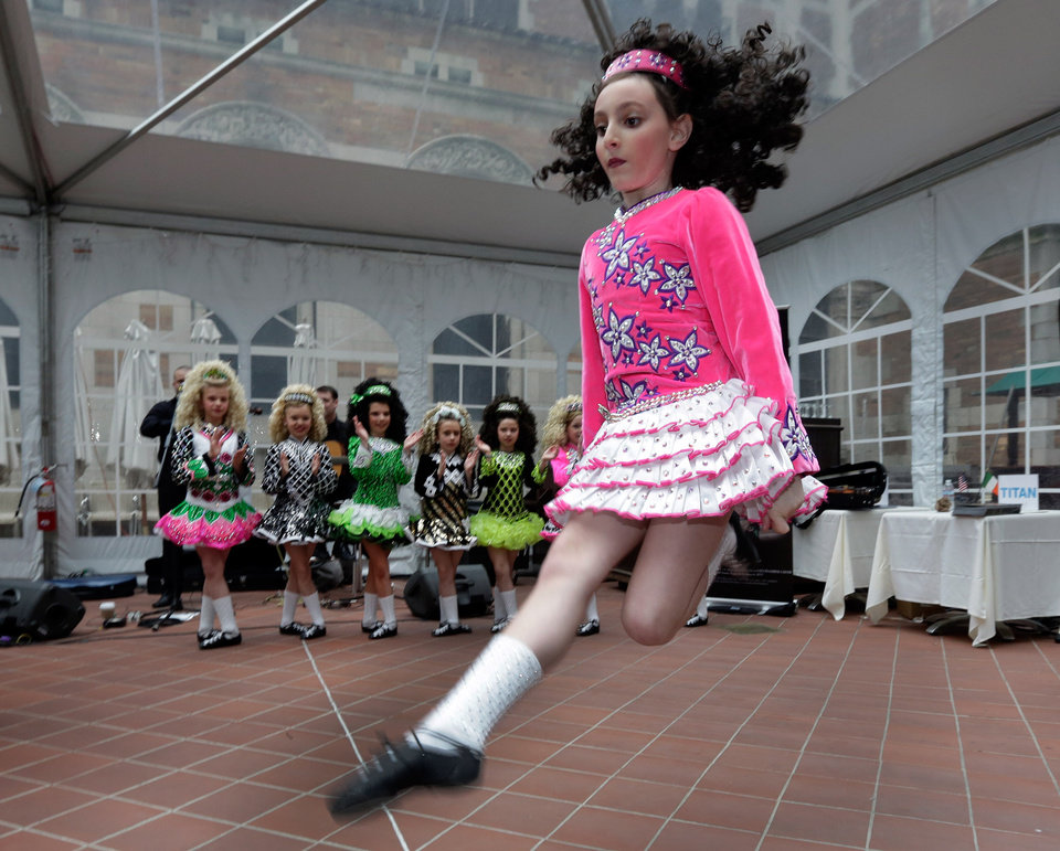 Photo - Members of the Petri School of Irish Dance perform at the Ireland Chamber of Commerce 17th annual St. Patrick's Day Breakfast, in New York,  Saturday, March 16, 2013. The Irish, their descendants and the Irish for the day prepared to don green and pay tribute to Hibernian heritage as a weekend of St. Patrick's Day celebrations was set from New York's Fifth Avenue to the Louisiana bayou to Dublin's Parnell Square. (AP Photo/Richard Drew)