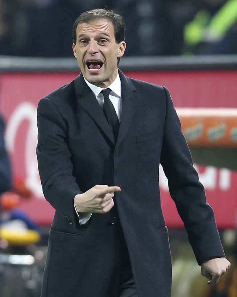 Photo - FILE - In this file photo take in Milan on Dec. 16, 2013, AC Milan former coach Massimiliano Allegri gestures during the Serie A soccer match between AC Milan and Roma. Massimiliano Allegri has been hired to coach Italian champion Juventus a day after Antonio Conte unexpectedly left the club. The 46-year-old Allegri was fired by Milan in January after 3 1/2 seasons with the squad, having led the Rossoneri to the Serie A title in his first year in charge in 2010-11.The 46-year-old Allegri was fired by Milan in January after 3 1/2 seasons with the squad, having led the Rossoneri to the Serie A title in his first year in charge in 2010-11. (AP Photo/Antonio Calanni)