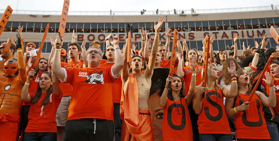 Photo - Oklahoma State fans cheer before a college football game between Oklahoma State University (OSU) and the University of Texas (UT) at Boone Pickens Stadium in Stillwater, Okla., Saturday, Sept. 29, 2012. Photo by Bryan Terry, The Oklahoman