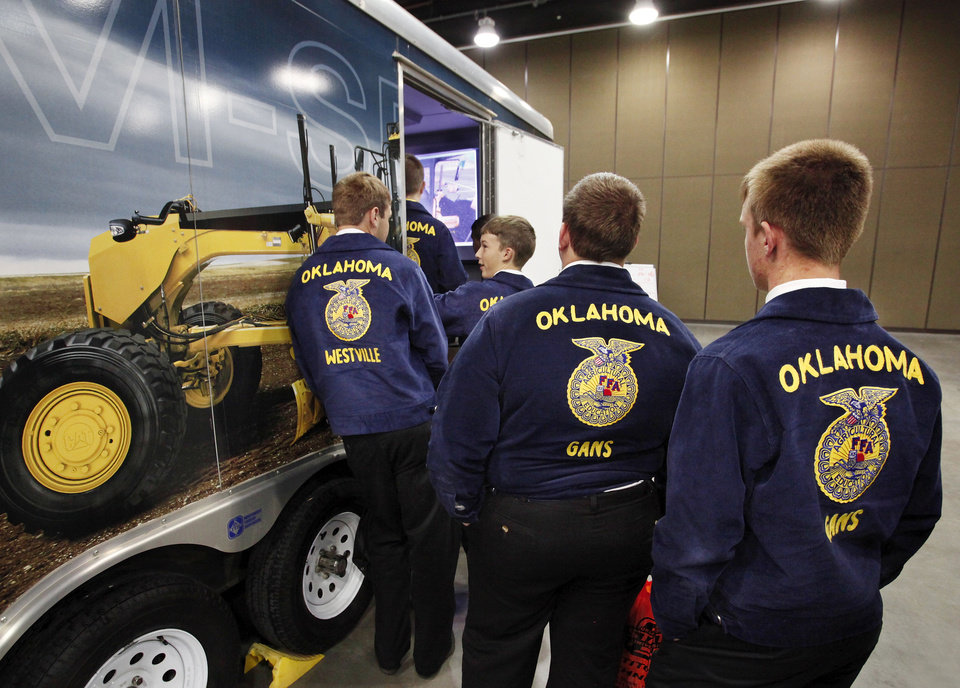 Boys wait in a line to step inside this trailer and operate the controls of the tractor simulator  at the trade show  at the annual state convention of FFA members at the Cox Convention Center in Oklahoma City,  on Tuesday, May 1, 2012.    Photo by Jim Beckel, The Oklahoman