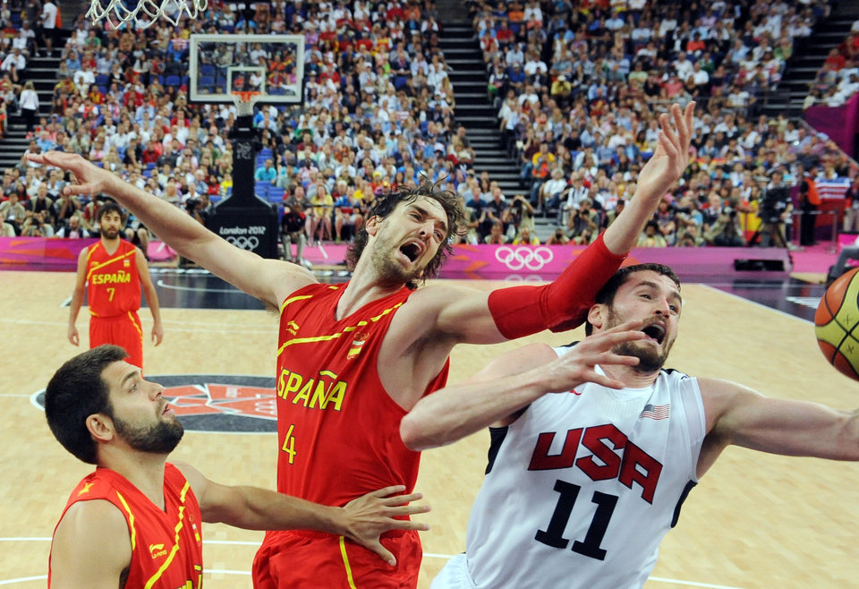 United States\' Kevin Love (11) vies for the ball with Spain\'s Pau Gasol (4) during the men\'s gold medal basketball game at the 2012 Summer Olympics in London on Sunday, Aug. 12, 2012. (AP Photo/Mark Ralston, Pool)