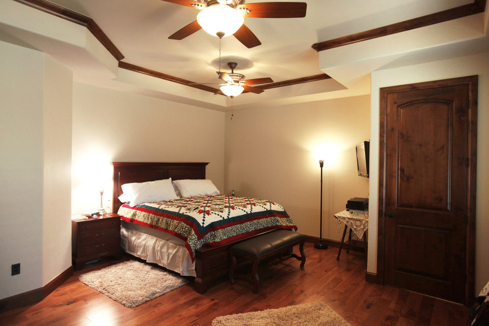 Rick and Sharron Wolf built their own house, their second one, with the aid of UBuildIt's Edmond office. This view shows the master bedroom.