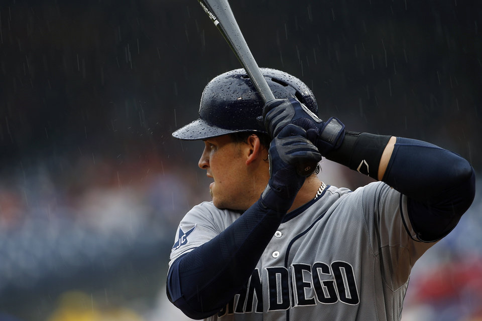 Photo - San Diego Padres' Yasmani Grandal bats in a rain storm during the fourth inning of a baseball game against the Philadelphia Phillies, Thursday, June 12, 2014, in Philadelphia. (AP Photo/Matt Slocum)