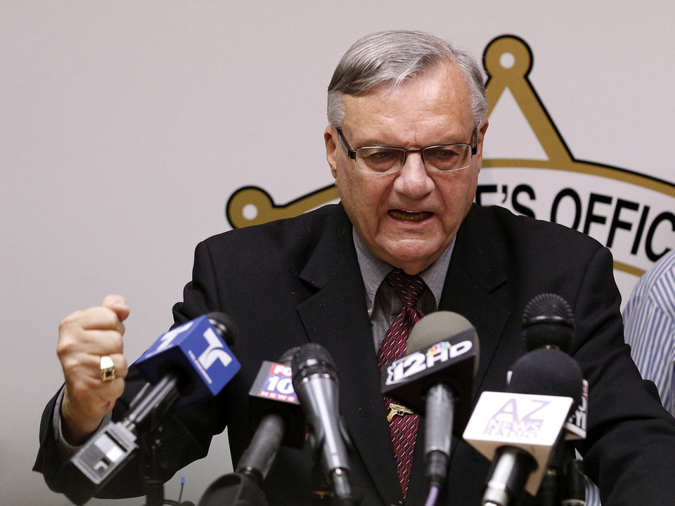 Photo -   A defiant Maricopa County Sheriff Joe Arpaio, pounds his fist on the podium as he answers questions regarding the Department of Justice announcing a federal civil lawsuit against Sheriff Arpaio and his department, during a news conference Thursday, May 10, 2012, in Phoenix. According to the Department of Justice, after months of negotiations failed to yield an agreement to settle allegations that the sheriff's department racially profiled Latinos in his trademark immigration patrols, the lawsuit was filed.(AP Photo/Ross D. Franklin)