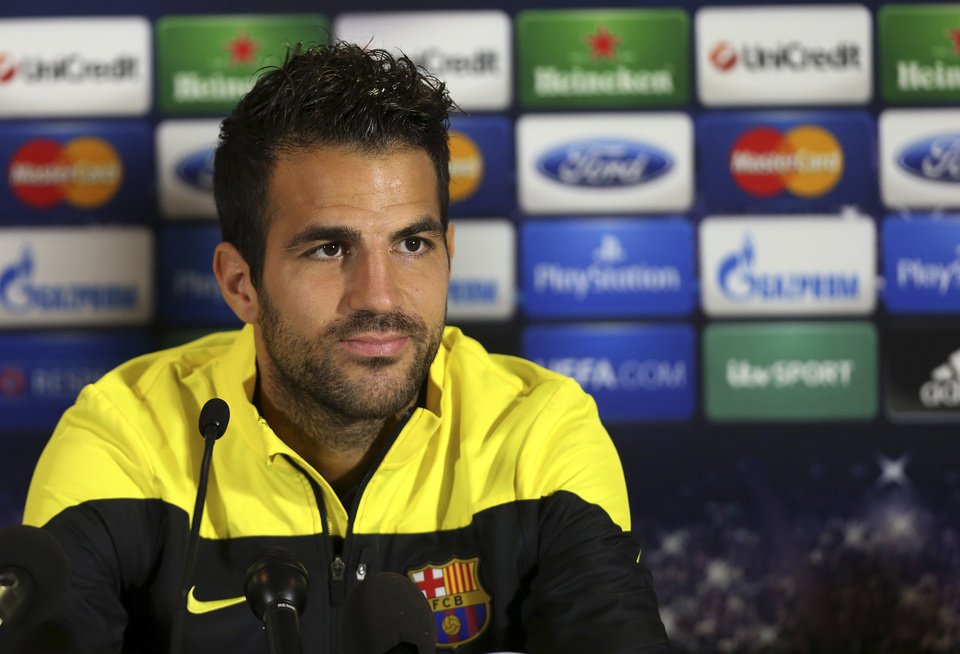 """Photo - FILE - A Monday, Sept. 20, 2013 photo from files showing Barcelona's Cesc Fabregas talking to the media during a press conference at Celtic Park, Glasgow, Scotland. Chelsea has announced on its website the signing of Cesc Fabregas from Barcelona on a five-year deal. The 27-year-old Fabregas, who has previously played for Chelsea's London rival Arsenal, says """"I do feel that I have unfinished business in the Premier League"""" and that Chelsea """"match my footballing ambitions with their hunger and desire to win trophies.""""  Fabregas, who is currently with Spain preparing for the World Cup in Brazil, will wear the number four shirt at Chelsea.(AP Photo/Scott Heppell, File)"""