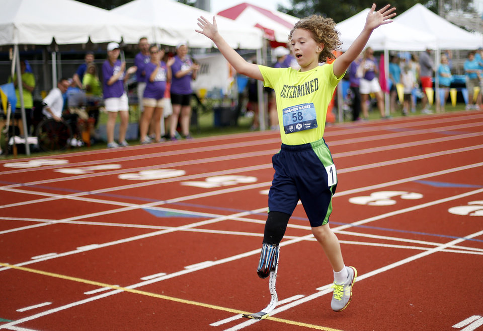 Dylan Jones reacts as he crosses the finish line during the UCO Endeavor Games at the Edmond North High School School track, Saturday, June 7, 2014. Photo by Bryan Terry, The Oklahoman