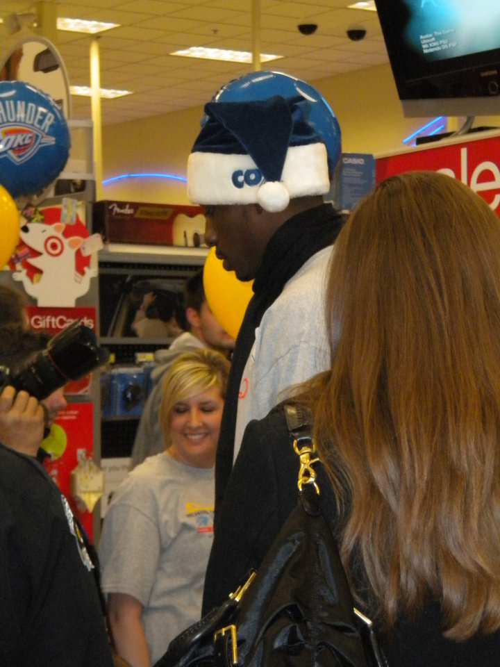 Photo -  A Thunder player talks to the families.