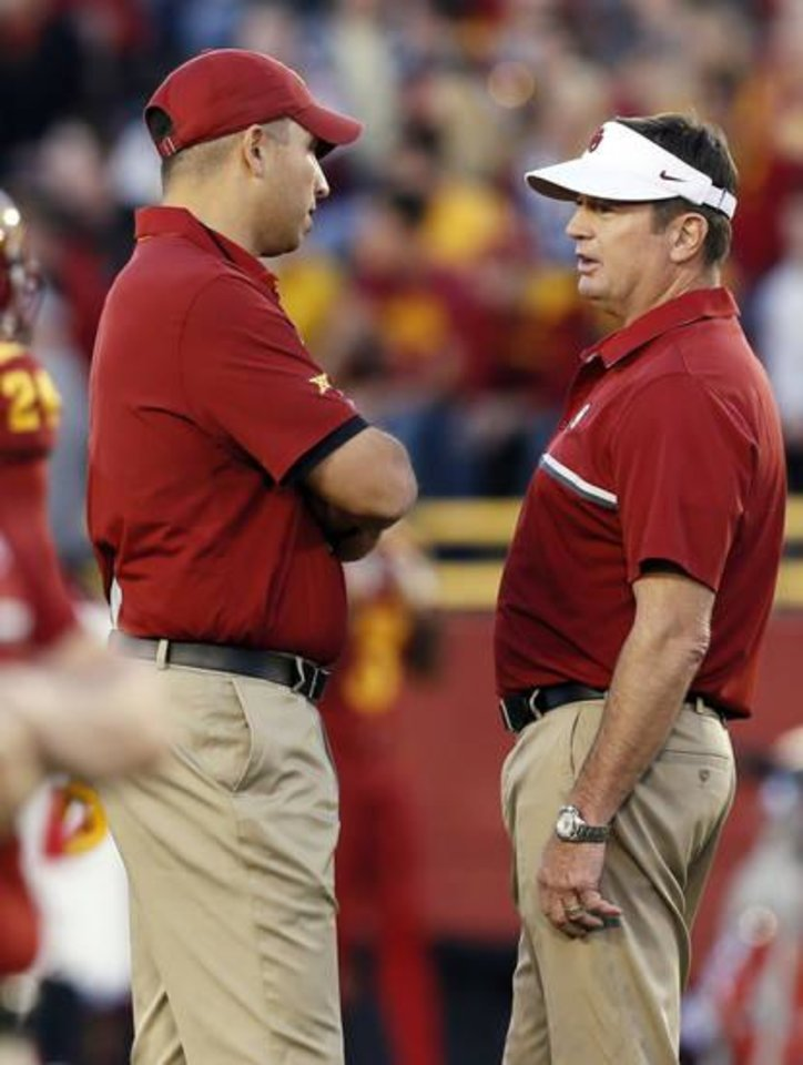 Photo - Matt Campbell and Bob Stoops chat before the OU-ISU game. (Photo by Nate Billings)