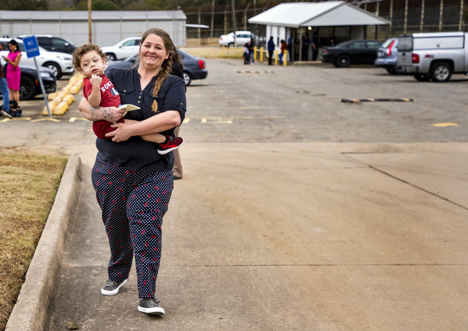 Photo - Donnie Crow is all smiles while she carries her son Fayedon Davis, 17 months, after she was released from the Dr. Eddie Warrior Correctional Facility on Monday, Nov. 4, 2019 in Taft, Okla. Governor Kevin Stitt greeted an estimated 70 women whose sentences he commuted from the facility. [Chris Landsberger/The Oklahoman]