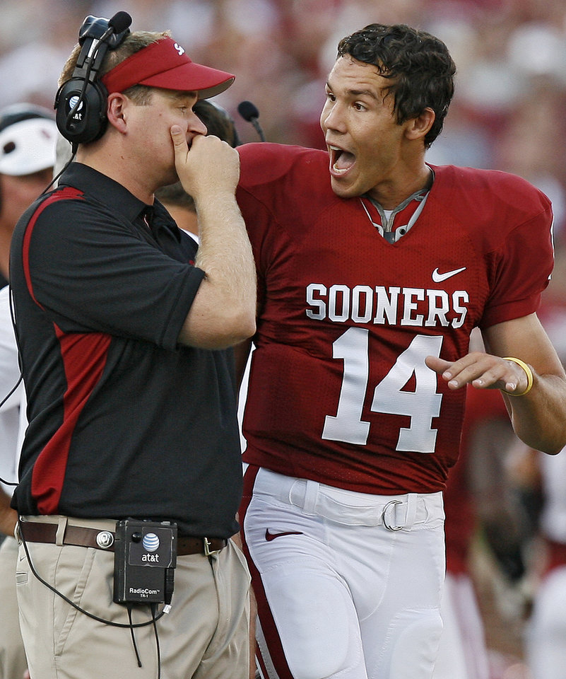 Photo - Oklahoma quarterback Sam Bradford (14) talks to quarterback coach Josh Heupel during the first half of the college football game between the University of Oklahoma Sooners (OU) and Texas Christian University Horned Frogs (TCU) at the Gaylord Family -- Oklahoma Memorial Stadium on Saturday, Sept 27,  2008, in Norman, Okla. By Bryan Terry, The Oklahoman ORG XMIT: KOD