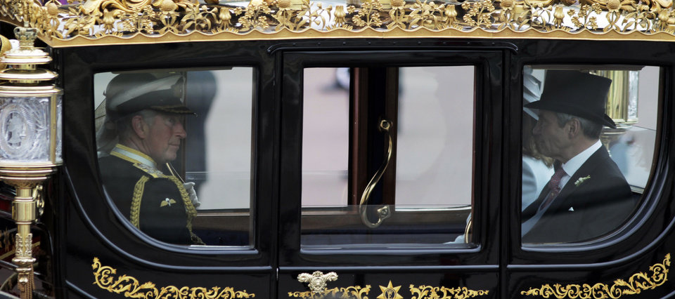 Photo - Britain's Prince Charles, left, rides in a carriage with Michael Middleton, Kate Middleton's father to Buckingham Palace after the Royal Wedding for Britain's Prince William and his wife Kate, Duchess of Cambridge  in London Friday, April, 29, 2011. (AP Photo/Lefteris Pitarakis)