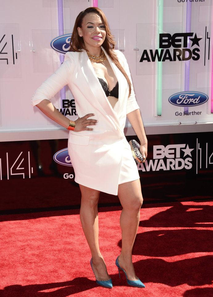 Photo - Faith Evans arrives at the BET Awards at the Nokia Theatre on Sunday, June 29, 2014, in Los Angeles. (Photo by Dan Steinberg/Invision/AP)