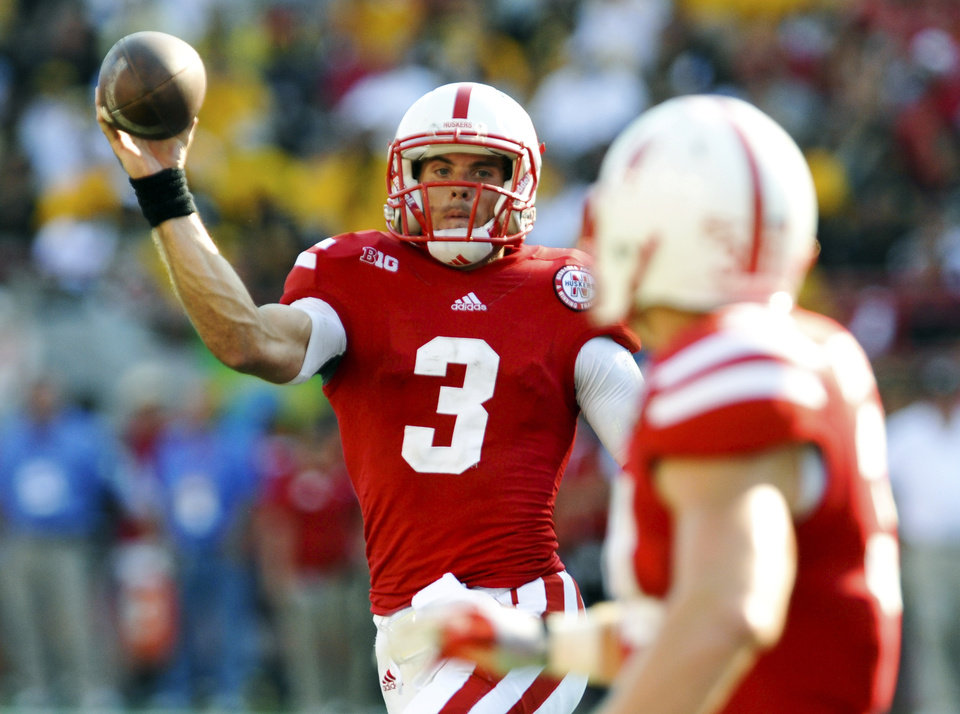 Nebraska quarterback Taylor Martinez (3) throws a pass to C.J. Zimmerer (31) during their NCAA college football game against Southern Mississippi, Saturday, Sept. 1, 2012, in Lincoln, Neb. (AP Photo/Dave Weaver) ORG XMIT: NEDW111