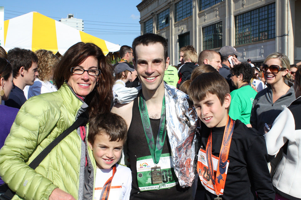 Photo - Adam Cohen is pictured with girlfriend Jamie Belknap, and his two sons, Theo, 8, left, and Will, 11, after the Oklahoma City Memorial Marathon. - Photo provided  ORG XMIT: 1004261544262985